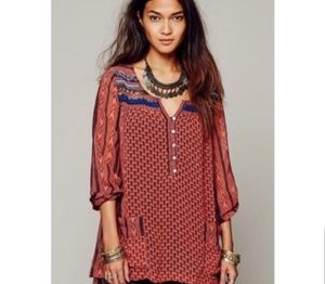 Free people feather in the wild beaded tunic.